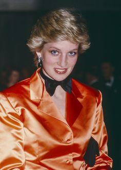 Princess Diana wearing an orange Jacket and bow tie Photo (C) GETTY IMAGES
