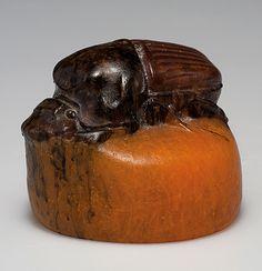 Amalric Walter, Nancy. 'Hanneton' paperweight, 1920s. H. 4.3 cm; D. 5.4 cm. Designed by Henri Bergé. Pâte de verre, moulded, mostly orange. Cockchafer with brown fusions. Marked: A. WALTER NANCY, HBergé sc.