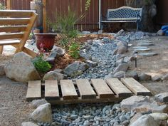 dry creek bed running the width yard - check out transformation photos.