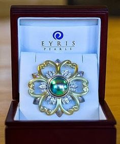 The Queen`s Blue Pearl brooch from New Zealand. Presented to the Queen while at Balmoral in September 2013 by the Prime Minister of New Zealand, Mr John Key. It is from Eyris Pearls in Christchurch & includes a large blue pearl surrounded by a design in the shape of a flower & the pearl is framed with 18 marquise diamonds, three in each petal.
