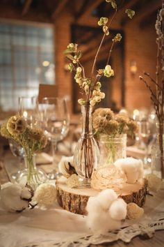 Rustic wedding centerpiece Flowers for all your special events. We made each one different and create them like a unique piece of art. We are a full service florist and boutique of local artist's creations. Visit us at ChloesCreationsFlorist.com of Facebook: https://www.facebook.com/ChloesCreationsFlorist