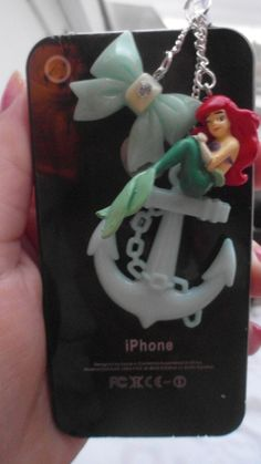 """The little mermaid Ariel anchor dangle pluggy ribbon bow disney inspired princess green blue chain link dust plug cap jack headphone. $7.99, via Etsy."""