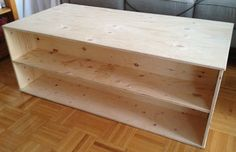 DIY $50 Coffee Table by sketchystyles.com. This would be great in a game / family room.  Store games on the shelves