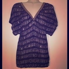 """Free People Sz XS Purple Gold Short Sleeve Blouse Free People Sz XS Purple Gold V Neck  loose short sleeve  Blouse Bust 32-34 Length 25""""  waist 12 1/2"""" 100% Modal Rayon  Slight stretch  New without tags! Free People Tops Blouses"""
