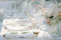 Classic Party Rentals, Wildflowers, wooden details, and mason jars coordinate with chandeliers and shimmery accents to create lovely, country-inspired events.