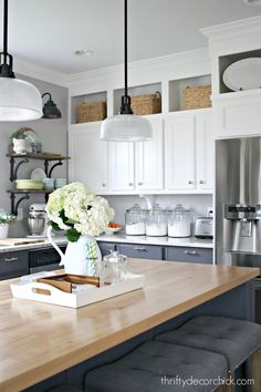 Decorate on top of kitchen cabinets, decorate on top of cabinets, decorate above kitchen cabinets, above cabinet decor, decorating above kitchen cabinets, above cabinet kitchen decor, above cabinet decorating, space between kitchen cabinets and ceiling