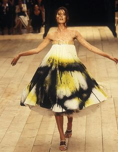 Alexander McQueen 1999'. Watch it. Amazing. http://www.youtube.com/watch?v=reK0A1XIjKA