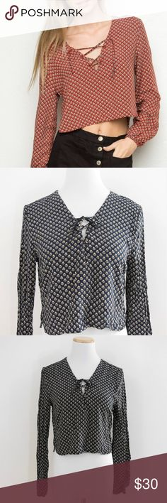 "NWT Brandy Melville Millie Lace-Up Top in Navy Brandy Melville Millie Lace-Up Top in Navy Print New with Tags  Details: - 100% rayon - Machine wash - Approx. 17"" length, 32.5"" bust laid flat  Let me know if you have any questions. Thanks for looking! Brandy Melville Tops Crop Tops"
