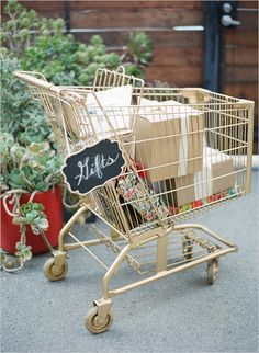 gold shopping cart for gifts #diy #gifttableidea #weddingchicks http://www.weddingchicks.com/2014/04/14/vintage-eclectic-california-wedding/
