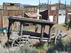"""Abandoned horse drawn hearse & vintage buildings in the old Chinatown area on """"I"""" St,Virginia City, Nevada"""