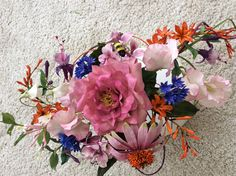 cottage garden flowers including rose, fuschia, sweet pea, montbretia, cornflower and echinacea