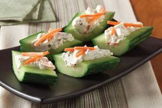 These Healthy Living appetizers are simplicity itself. Smooth chive and onion cream cheese is a perfect match for crunchy cucumbers and carrots.