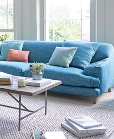 Loaf's deep and squashy Hunker sofa with pleated arms in blue linen