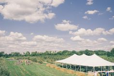 Tented field wedding with staged entryway  leading to the ceremony site = great use of space LOVE THIS!