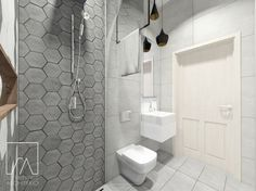 Łazienka, w której projektant Sztyblewicz wykorzystał jasnoszare płytki i nowoczesne,szare heksagony.