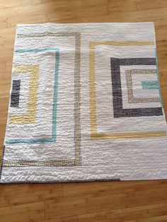Modern Baby Boy Quilt with wavy quilting by LadyInThread on Flickr.
