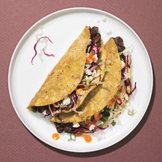 CRISPY BLACK BEAN TACOS - I've made a few adjustments to this recipe: use a can of refried black beans (instead of doing the smashing myself), substitute queso fresco for feta and add pan roasted corn to the coleslaw mixture.