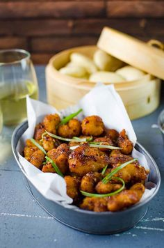 Deliciously easy, Spicy Asian Popcorn Shrimp Bao - Perfect forbusy weeknights. Restaurant-quality, flavor-packed meal in just 15 - 20 minutes with crispy oven-baked popcorn shrimp, tossed in a spicy Asian sauce and then served with slider buns.