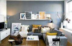 Love the couch and the shelving.