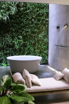 Spa Retreat: Beautiful outdoor indoor relaxation area with a waterfall tubfiller