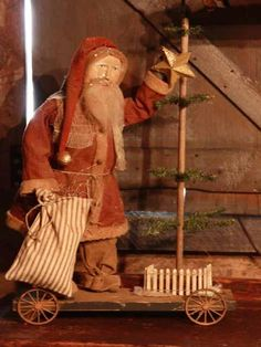 Folk Art Santa with toy sack and primitive tree.