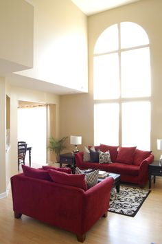 Working on this look for my living room. Red couch and chair with black furniture and black and white accents. Everything goes beautifully with red.