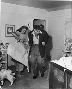 Married actors Orson Welles and Rita Hayworth pretending to bullfight (she's the toreador, and he's the bull) at home.    California, 1945, Peter Stackpole.    via byronic