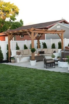 A pergola offers shade to a paver patio with custom seating in Room For Tuesday's new and improved backyard. This space is made for outdoor entertaining! Backyard Pergola, Small Backyard Landscaping, Fire Pit Backyard, Landscaping Ideas, Backyard Pools, Backyard Storage, Backyard Seating, Cozy Backyard, Pergola Roof