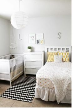 Very gender neutral bedroom/nursery. White, black and yellow
