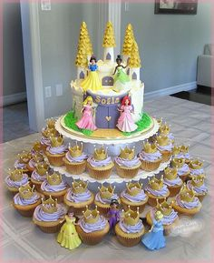Princess Castle Cake and Cupakes with dolls provided by the customer