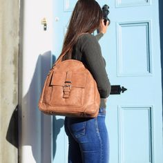 The Tan Aine is a multifunctional handbag that lets the exquisite leather make all the impact. Made in the finest calfskin leather with antique brass hardwear. Christmas Gifts For Teen Girls, Gifts For Teens, Leather Handbags Uk, Leather Backpack, Leather Bag, Etsy Uk, Leather Handle, Purses And Bags, Tote Bag