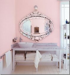 Absolutely gorgeous bathroom from Gingerella.  Love the pink, Venetian mirror and marble!