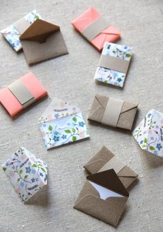 24 tiny envelopes, hand assembled from LDPs own patterned paper - hand drawn illustrations of botanicals printed on vellum paper, kraft brown and Design Origami, Origami Fish, Oragami, Fun Origami, Dollar Origami, Origami Ball, Origami Bookmark, Paper Crafts Origami, Origami Tattoo