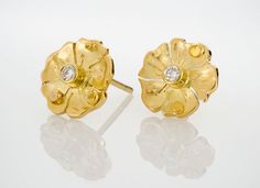 Pansy Earrings are getting ready for spring! Sweet for teens to grams..18K gold, .08 CTTW diamond.