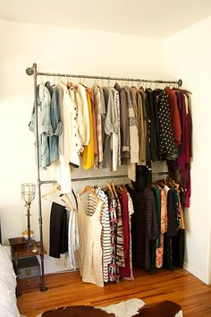 "diy pipe clothing rack @ Home Design Ideas. Something like this might work in the dormers in our bedroom. Then we'd have more ""closet"" space. Closet Bedroom, Closet Space, Diy Bedroom, Trendy Bedroom, Closet Redo, Modern Bedroom, Bedroom Furniture, Master Bedroom, Makeshift Closet"