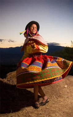Liz performs in a folk dance group in Peru, showcasing the grace and history of her community.
