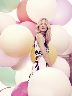 I need to try this one day - photograph a model with a ton of balloons...