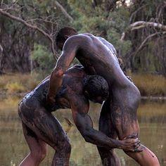 Answer, naked men mud wrestling something