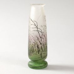 "This is not contemporary - image from a gallery of vintage and/or antique objects. Daum ""Rain"" Vase  A French Art Nouveau etched and enameled glass ""Rain and Wind"" scenic vase by Daum, featuring a detailed landscape with blowing wind and rain, bending the branches of the trees."