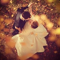 Great angle for a bride and groom shot through the fall leaves.