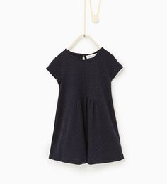 Dress with a bow and tiny polka dots