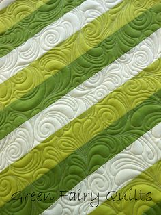 This quilting really gets showcased on top of such simple strip piecing. Bag detail by Judi Madsen of Green Fairy Quilts.