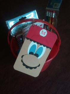 used SU punches to make Mario tag, tied onto red plastic bucket filled with Mario goodies