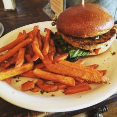 #VeggieBurger from Bon Vivant Market & Cafe topped with #sweetpotatofries, #avocado, #saffronoil, on a #brioche bun. #tasty #lunch