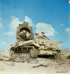 Knocked out panzer 4 in Afrika. Brithis soldiers inspect it. My colored picture.