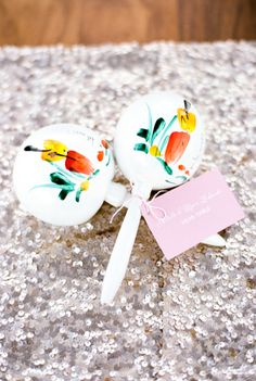 Mexican inspired maracas: http://www.stylemepretty.com/destination-weddings/mexico-weddings/2016/08/24/color-filled-wedding-in-cabo-san-lucas-mexico/ Photography: Nancy Aidee - http://www.nancyaidee.com/