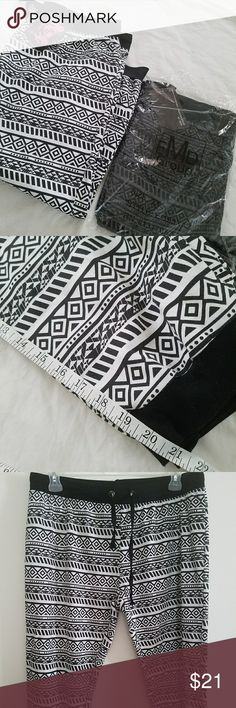 """Aztec Printed Joggers Bundle 2X New. Tried on couldnt fit. Purchased on Groupon.  Color: White & Charcoal gray. Very nice Joggers. Measurement inseam 21""""inches. Thigh is 28"""" inches around. Waist is 18"""" stretches comfortably to 21"""". Material 55% cotton 45% polyester. Bottoms up Pants Track Pants & Joggers"""