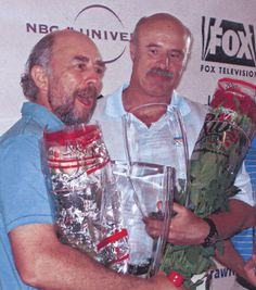 Dr. Phil and Richard Schiff holding Rio Roses at an Emmy Awards event