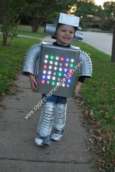 Coolest Homemade Robot Kids Halloween Costume colored Xmas lights covered with white plastic leg caps from Home Depot glued on for a more light-bulby effect Halloween Gif, Halloween Tutorial, Fete Halloween, Halloween Movies, Holidays Halloween, Halloween Costumes For Kids, Halloween Crafts, Halloween Makeup, Halloween Recipe