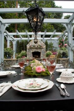 My table setting - a few years ago - now the pergolas are covered with vines and roses